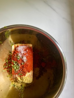 Add spices to the butter.