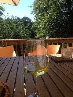 Enjoy a glass of wine on the large outdoor deck overlooking the water