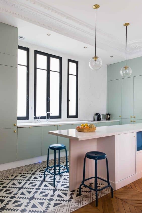 une cuisine avec ilot central aux couleurs pastel - 8 façons de mettre en valeur l'ilot central de la cuisine