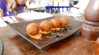 Fried risotto balls with seafood filling
