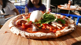 Burrata pizza. Burrata cheese is made out of mozarella scraps and fresh cream, stuffed in a thin layer of mozzarella and then wrapped tightly in a ball.