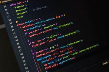 A photo of a screen with Visual Studio Code and some code.