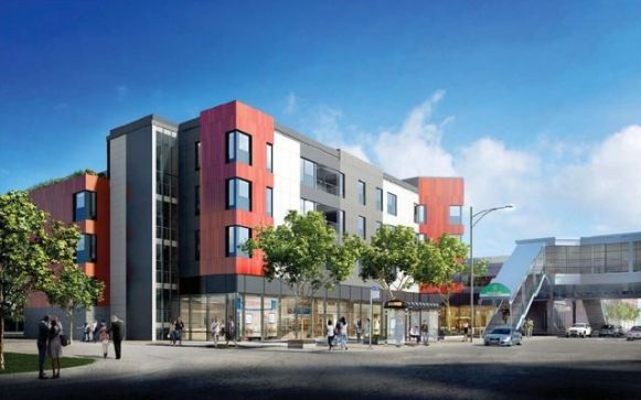 A rendering of the proposed Woodlawn Station development next to the Cottage Grove Green Line station.
