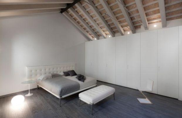 Camera da letto con letto Cassina