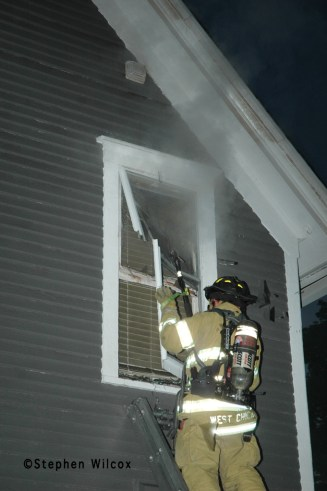 Wheaton house fire on Ellis 6/17/11 firefighter vents window VENT, ENTER, SEARCH
