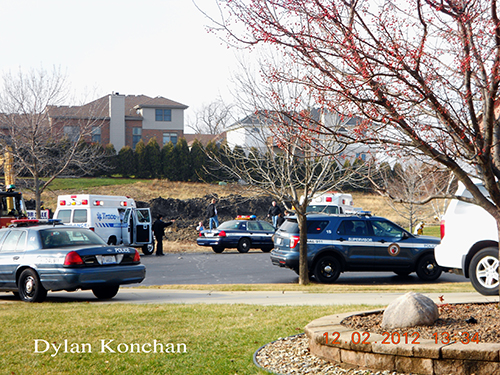 2 people trapped in a hole  at 18307 White Oak Ct in Tinley Park
