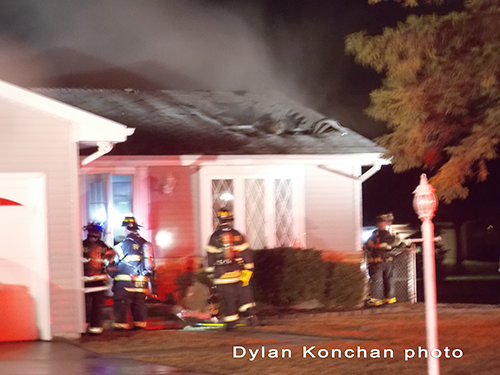 firefighters working at house fire
