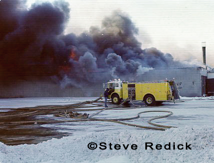 fire trucks at bitter cold winter fire