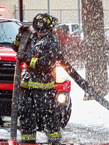 Chicago fireman at winter fire scene