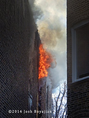 flames shoot out upper floor window