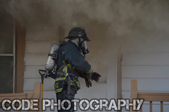 firefighter making entry