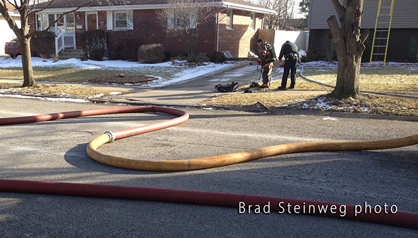 large diameter fire hose at fire scene