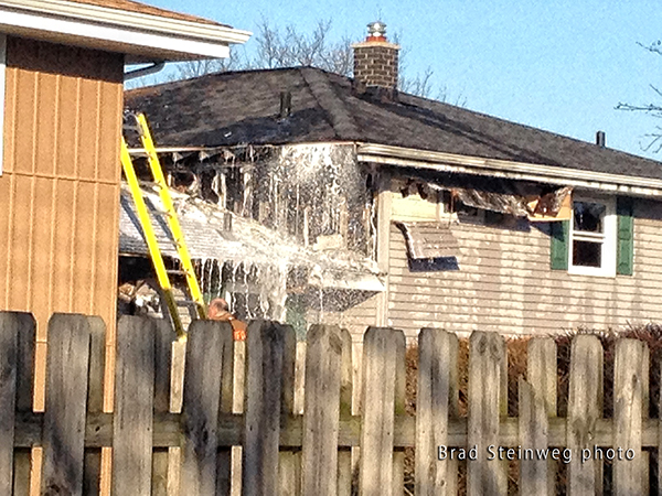 firemen use foam at house fire