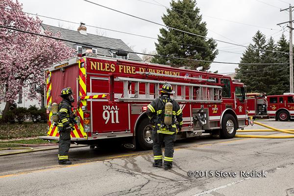 firemen use hydraulic ladder rack