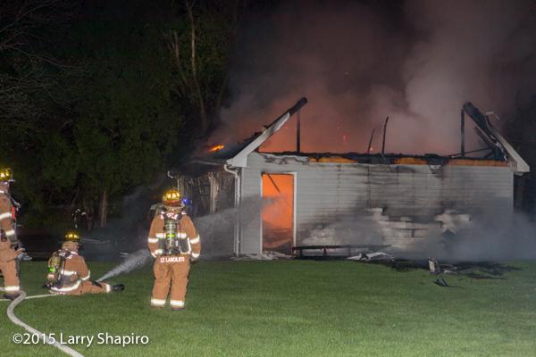 firemen fight a garage fire