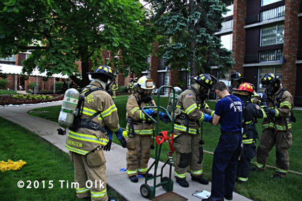 firemen prepare to remove hazardous chemical from building