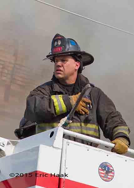 Chicago fireman in Snorkel basket