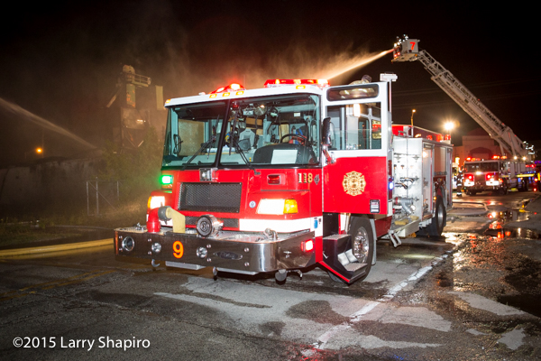 Pierce Quantum fire engine flowing at night fire scene
