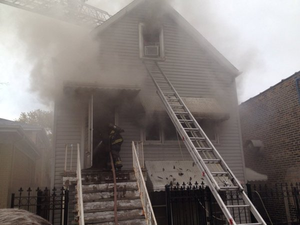 house fire with ladder to the second floor window
