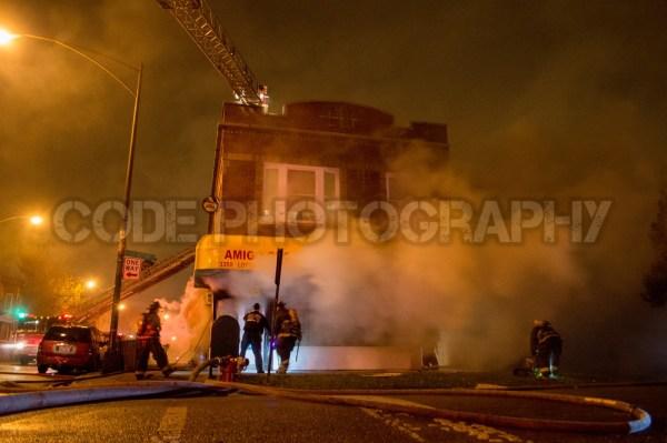 smoke from corner store at night fire scene