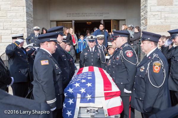 fire department honor guard carries casket