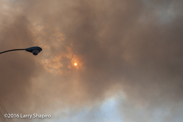 smoke from large fire obscures the sun