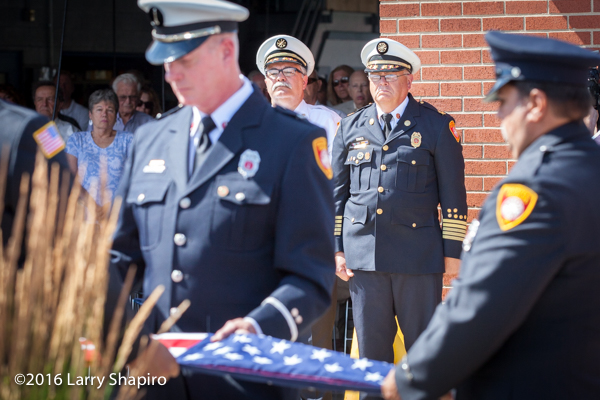 fire department honor guard folds American flag