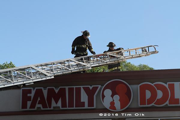 firemen climb aerial ladder