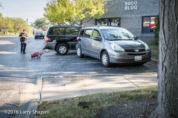 crash site with mini van and SUV