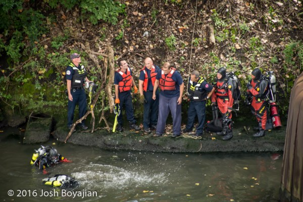 fire department divers search for victim in river