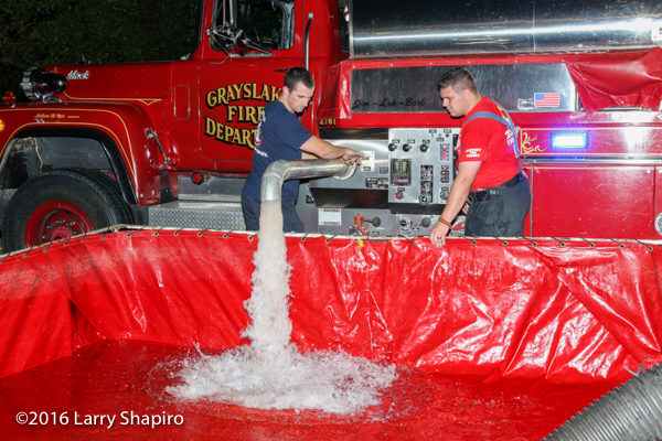 Grayslake FD tender dumps water at fire scene