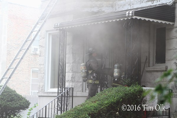 firefighters making entry through smoke