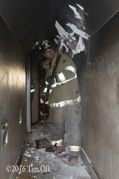 firefighter pulling ceiling