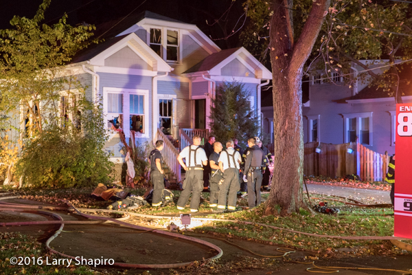 Firefighters outside house after battling a fire