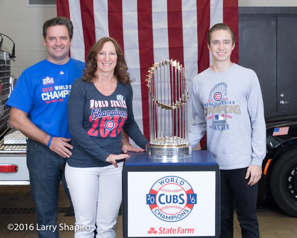 Firefighter and family with the the World Series championship trophy