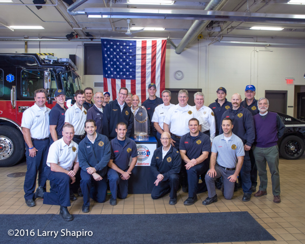 Winnetka fire department personnel with the the World Series championship trophy