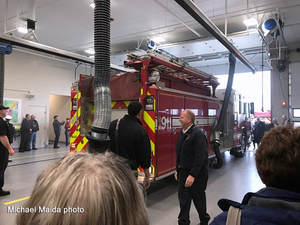 fire engine being pushed into new fire station
