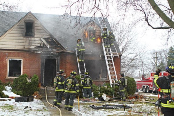 house fire scene with firefighters