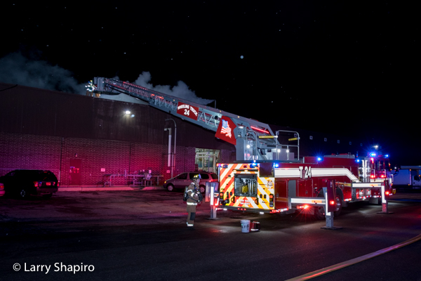 Rosenbauer America Commander Cobra tower ladder at night fire scene with lights