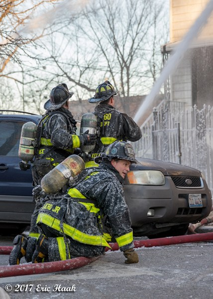 firefighters covered with ice battling a fire