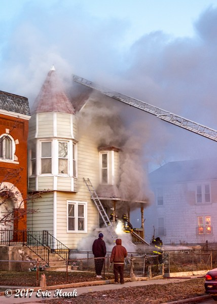 aerial ladder to roof during house fire