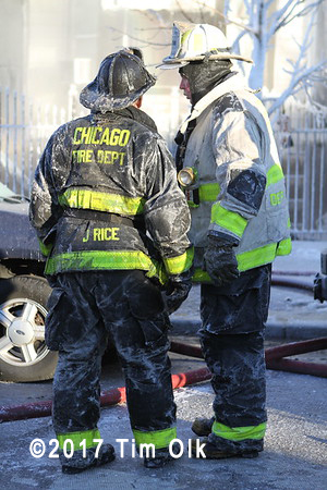 firefighters covered with ice after fire