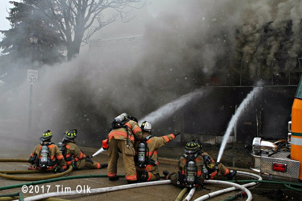 firefighters battle fire with multi-versals
