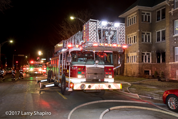 Oak Park E-ONE tower ladder at night fire scene
