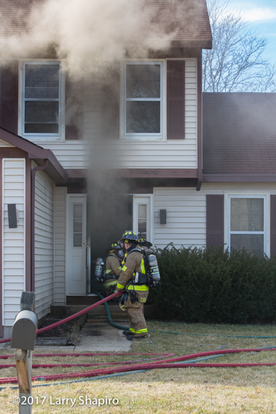 Firefighters make entry into house on fire