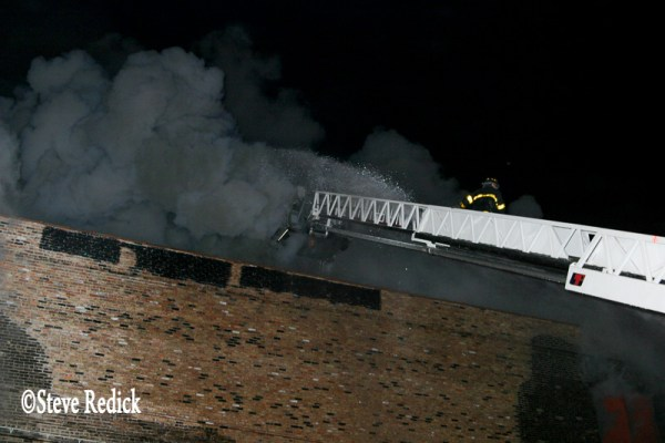 heavy smoke from warehouse fire at night