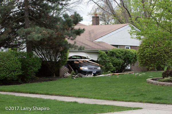elderly driver crashes car through garage of a house