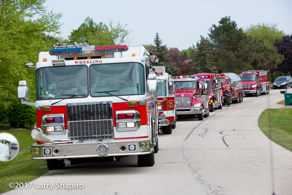 fire trucks staged in a line