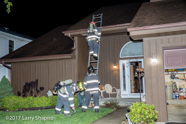 Firefighters descend ground ladder