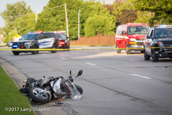 motorcycle in roadway after crash
